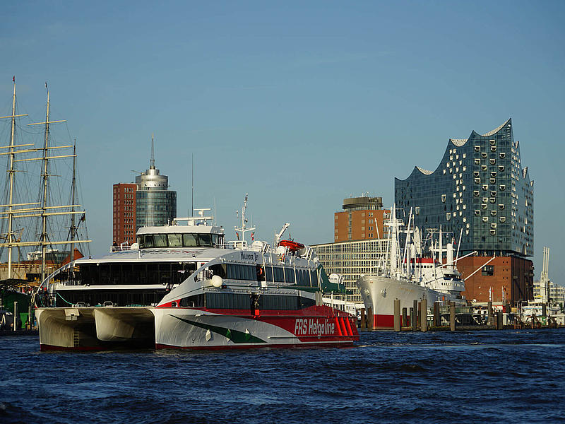 The high speed craft Halunder Jet in front of the Elbphilharmonie in Hamburg.