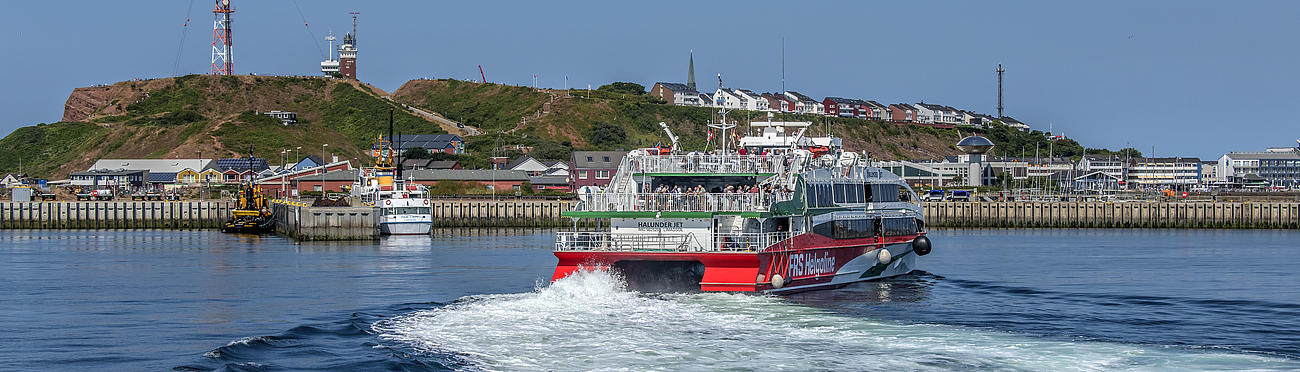 High speed craft Halunder Jet arriving at the port of Heligoland.